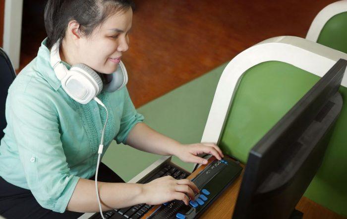 Woman using braille keyboard
